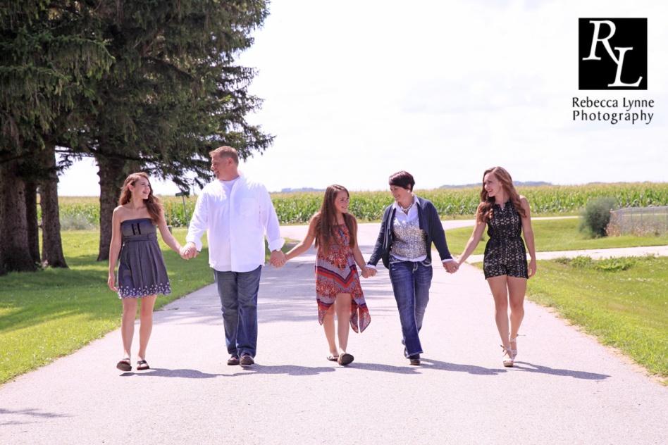 Family walking down road