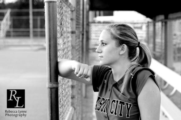 beautiful black and white softball dugout senior girl