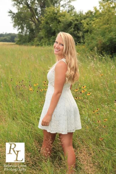 Senior girl high school portrait field flowers white dress