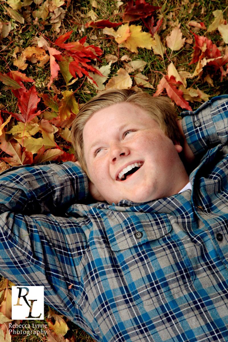 Fall Portrait Grown Boy in Leaves
