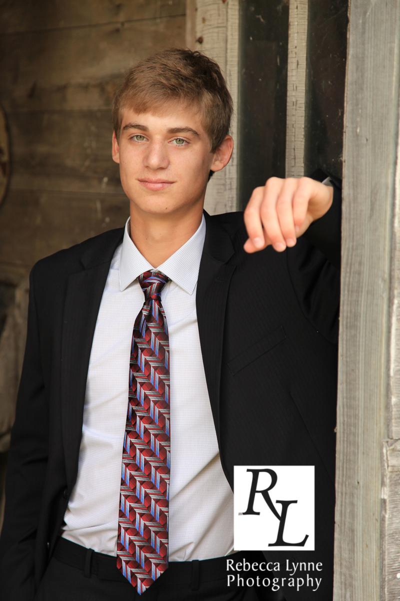 High School Senior Guy suit outdoors